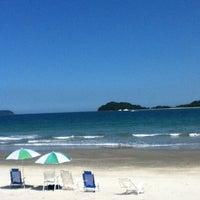 Photo taken at Praia Preta by Cristian F. on 2/17/2012