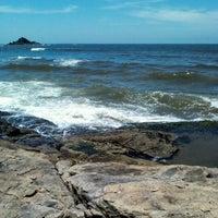 Photo taken at Praia do Sonho by Panambi O. on 2/5/2012