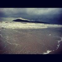 Photo taken at Pantai Cenang (Beach) by Nora M. on 6/6/2012