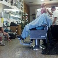 Photo taken at Del's Barber Shop by Tim C. on 8/17/2012