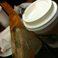 Photo taken at Starbucks by Yukiko M. on 3/8/2012
