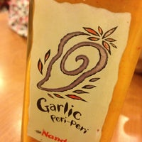 Photo taken at Nando's by Fizzie M. on 2/14/2012