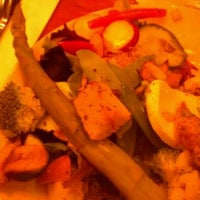Photo taken at Flame Rotisserie Grill & Bar by Linzi H. on 2/13/2012