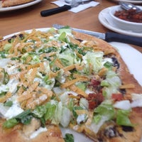 Photo taken at California Pizza Kitchen by Erica W. on 3/22/2012