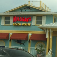 Photo taken at Mulligan's Beach House Bar & Grill by Kathy on 8/16/2012