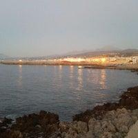 Photo taken at Rethymno Beach by Roula K. on 7/22/2012