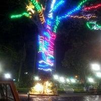 Photo taken at Parque Central de Alajuela by Víctor V. on 12/7/2011