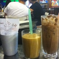Photo taken at Canai Cafe by Husna Z. on 8/7/2011