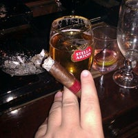 Photo taken at Stanley's Cigar Lounge by Austin R. on 1/8/2012
