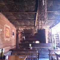 Photo taken at Restaurant Casa de Piedra by Daniela P. on 8/12/2012