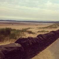 Photo taken at Swansea Bay Beach by Mohammed A. on 5/27/2012