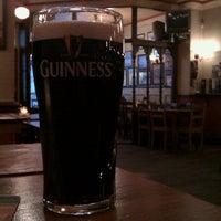 Photo taken at John Mullins Irish Pub by Joshua R. on 12/5/2011
