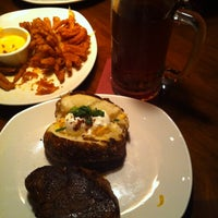 Photo taken at Outback Steakhouse by John G. on 3/20/2012