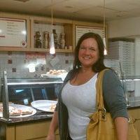Photo taken at Pomodoro Pizza by Scott B. on 9/1/2011