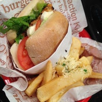 Photo taken at Red Robin Gourmet Burgers by Tracy A. on 1/31/2012