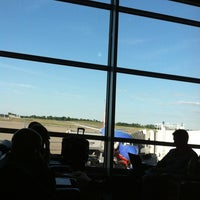Photo taken at Gate E8 by Caitlin P. on 6/7/2012