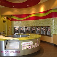 Photo taken at Menchie's Red Bug Village by Montse M. on 3/10/2012