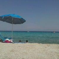 Photo taken at Armenistis Beach by Michalakos O. on 7/31/2012