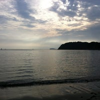 Photo taken at Zushi Beach by Yoshihiko T. on 6/18/2012