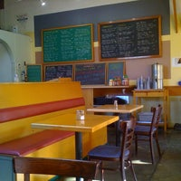 Photo taken at Tomate Cafe by Horace W. on 11/9/2011