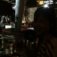 Photo taken at Cafe' De Beach by Chani T. on 8/1/2012