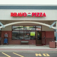 Photo taken at Bravo Pizza by Joe S. on 3/16/2011