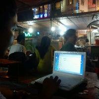 Photo taken at Angkringan Nasi Kucing Mas Jojo by Vivi A. on 5/4/2012