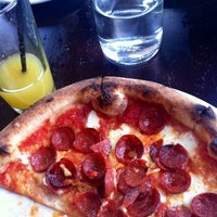 Photo taken at RedRocks FireBrick Pizzeria by Ci R. on 6/3/2012