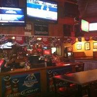 Photo taken at Mulligan's Pub by Ashley V. on 6/5/2011