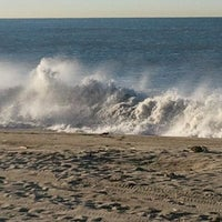Photo taken at 'Hole in the Fence' Beach by Elsa on 3/27/2012