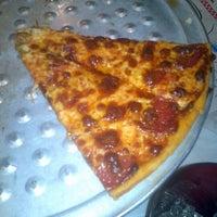 Photo taken at Bariola's Pizzeria by Kim W. on 12/10/2011