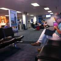 Photo taken at Concourse C by Nai B. on 7/4/2012