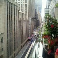 Photo taken at Club Quarters Hotel, opp Rockefeller Center by Jennifer B. on 8/10/2012