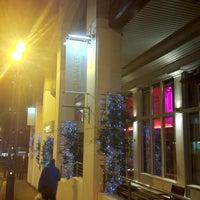 Photo taken at The Chameleon Restaurant & Bar by Kevin M. on 1/5/2012