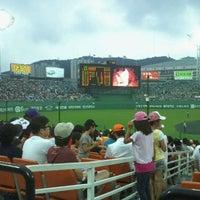 Photo taken at Sajik Baseball Stadium by Alex Y. on 8/4/2011