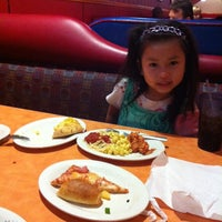 Photo taken at John's Incredible Pizza Company by Gift T. on 3/18/2012