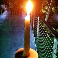 Photo taken at Trey Pennington Candlelight Memorial At Liberty Bridge @ Falls Park by John Adam W. on 9/8/2011