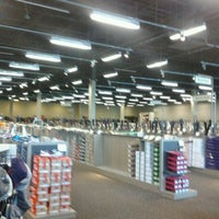 Photo taken at DSW Designer Shoe Warehouse by Carrie C. on 9/5/2011