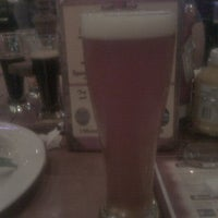 Photo taken at Triple 7 Restaurant & Brewery by Scott V. on 10/1/2011