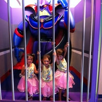 Photo taken at Buzz Lightyear's Space Ranger Spin by Jon G. on 8/20/2011