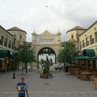 Photo taken at Fidenza Village by Davide B. on 7/13/2011