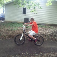 Photo taken at the woods BMX track by Benjamin H. on 6/21/2012