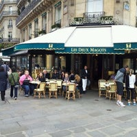 Photo taken at Les Deux Magots by Benjamin H. on 3/10/2012
