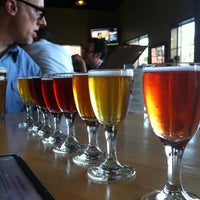 Photo taken at Cascade Brewing Barrel House by emuchico W. on 4/25/2012