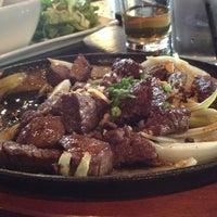 Photo taken at Saigon Kitchen by Paul B. on 4/15/2012