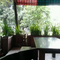 Photo taken at Cafe Taman Koleksi by Natasya C. on 2/6/2012