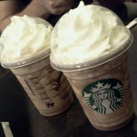 Photo taken at Starbucks by Daniela R. on 7/1/2012