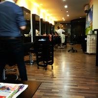 Photo taken at U Sense Hair Studio by Patrick T. on 7/12/2012