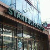 Photo taken at Starbucks by Elina H. on 7/7/2012