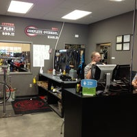 Photo taken at Mad Dog Cycles by Ben B. on 5/14/2012